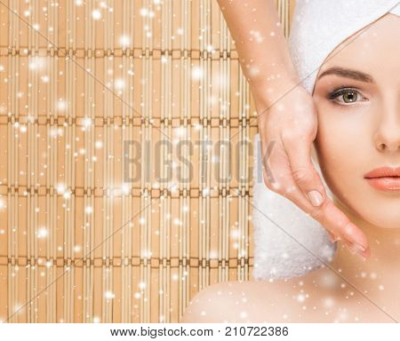 Young and healthy woman getting health care treatments in massaging salon. Winter and Christmas spa concept.