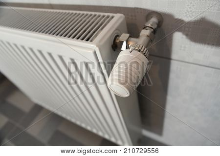 white heating radiator under in the room
