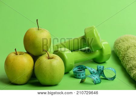 Barbells Near Juicy Green Apple. Sports And Healthy Regime Equipment