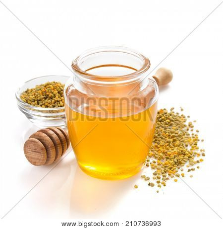 jar of honey and bee pollen isolated on white background