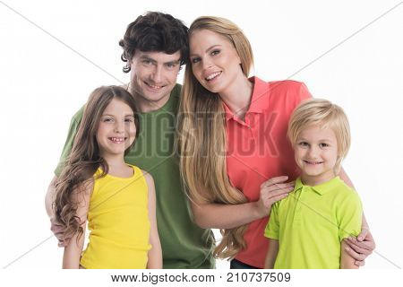 Happy smiling family of two parents and two children isolated on white background
