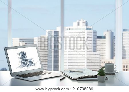 Workplace of insurance broker in office with view on cityscape