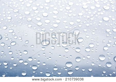 Water drops on glass, closeup