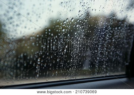 Wet car window, closeup