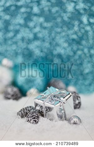 Christmas gift with glitter blue background as greeting card