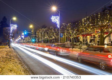 GDANSK, POLAND - JANUARY 8, 2017: Beautiful winter illumination on snowy street of Gdansk, Poland. Gdansk is the historical capital of Polish Pomerania.