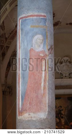 LUCCA, ITALY - JUNE 03: Fresco on the column depicting Saint Helen, Basilica of Saint Frediano, Lucca, Tuscany, Italy on June 03, 2017.