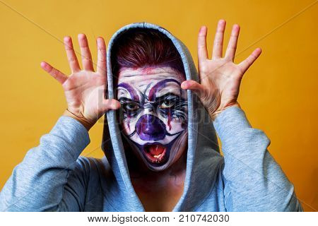 woman with body painting on her face, ugly scary clown, Halloween topic