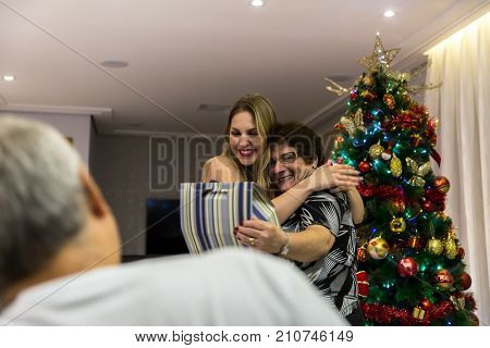 Family on the living room exchanging christmas presents