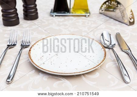 Table Setting With Plates, Knife, Fork And Spoon