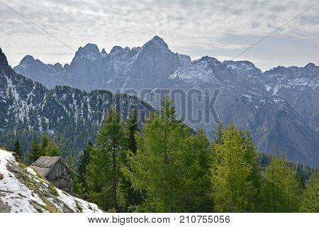 The view from Monte Lussari in Friuli Venezia Giulia north east Italy in late September. The first snows have fallen but not enough to open the ski slopes yet. poster