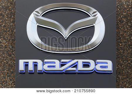 Skanderborg, Denmark - October 21, 2017: Mazda logo on a facade. Mazda is a Japanese automaker based in Fuchu, Japan