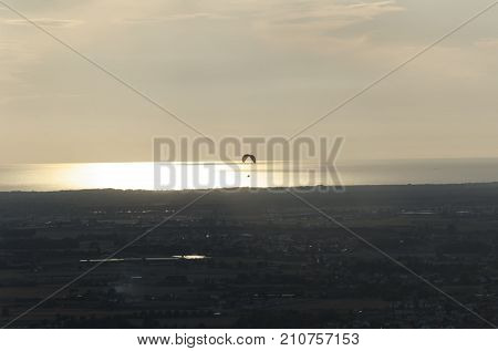 View of a paragliding practice at the sunset