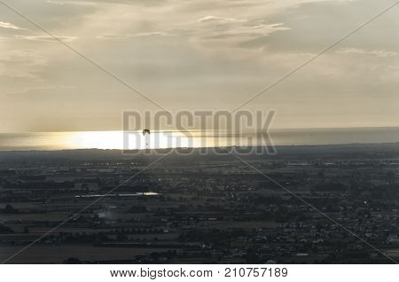 View of a paraglider at the sunset