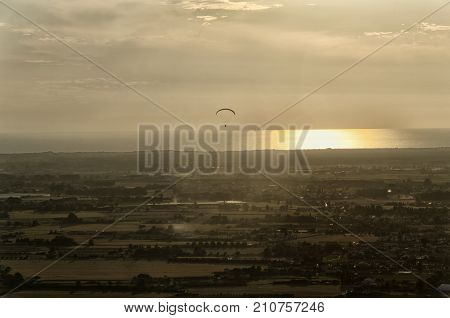 View of a paraglider above the sea