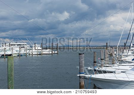 ATLANTIC HIGHLANDS NEW JERSEY - September 30 2017: The Atlantic Highlands Marina is seen on a cloudy fall day with the Manhattan skyline in the distance.