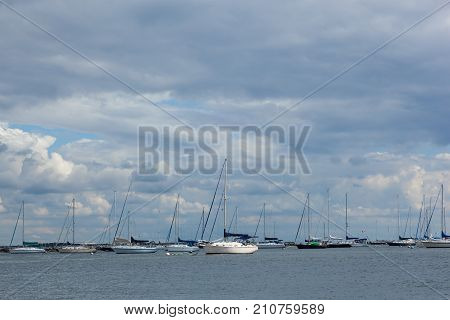 ATLANTIC HIGHLANDS, NEW JERSEY - September 30, 2017: Sailboats are moored in the Atlantic Highlands Marina on a cloudy fall day