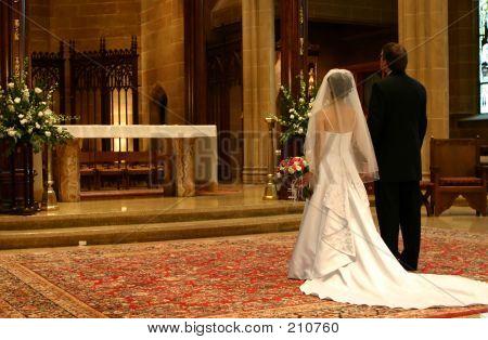bride and groom at altar (closeup) poster