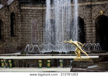 PETERHOF, SAINT-PETERSBURG, RUSSIA - JUNE 10, 2016: Fighter Borghese. The sculpture of the Grand cascade in Petergof. Scenic view of Grand Cascade in Peterhof palace Saint Petersburg Russia