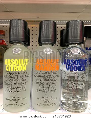 Alameda CA - October 05 2017: Grocery store shelf with bottles of Absolut Vodkas. Original and flavored. Absolut Vodka is a brand of vodka produced near Åhus in southern Sweden.