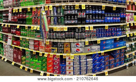 Alameda CA - October 08 2017: Grocery store shelf with various brands of soda in cans. Pepsi Co is one of the largest corporations in the non-alcoholic beverage industry.