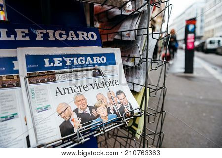 PARIS FRANCE - SEP 25 2017: Le Figaro with Bitter Vitory message about Angela Merkel winning election in Germany for the Chancellor of Germany the head of the federal government