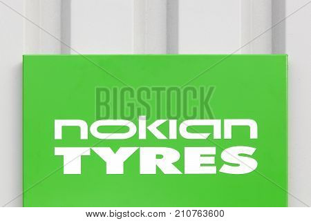 Skanderborg, Denmark - October 21, 2017: Nokian Tyres sign on a wall. Nokian Tyres headquartered in Nokia, Finland, produces tyres for cars, trucks, buses and heavy duty equipment