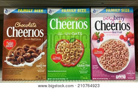 San Leandro CA - October 15 2017: Grocery store shelf with boxes of General Mills brand Cheerios cereal in a variety of new flavors.