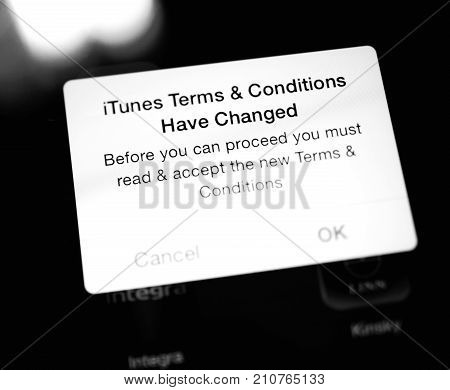 PARIS FRANCE - SEP 18 2014: iTunes Terms and Conditions have changed message on the Retina screen of an iPad iPhone during iOS update