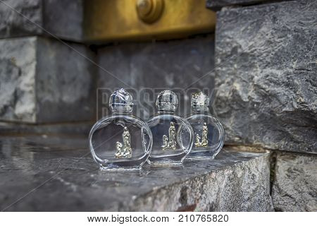 Holy water in a beautiful small bottles. Lourdes, France