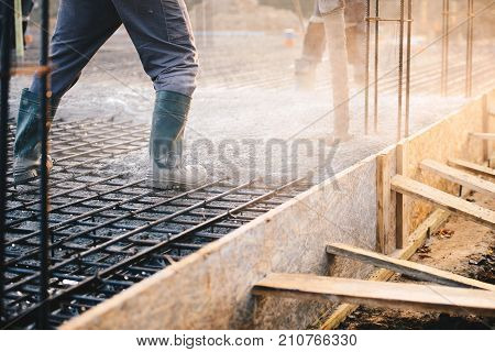 Concrete Pouring During Commercial Concreting Floors Of Buildings In Construction