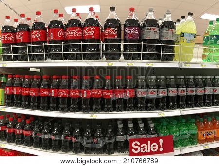 Alameda CA - October 16 2017: Grocery store shelf with bottles and cans of coca cola regular and diet. Coke products were sold in over 200 countries worldwide.