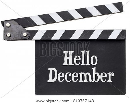 Hello December movie title in white chalk on clapboard isolated on white