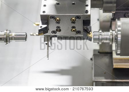 Close up of the CNC lathe jaw clamping raw material steel rod .Steel Cylinder part after turning process. Hi-precision CNC machining concept.Raw material steel rod for CNC lathe precess