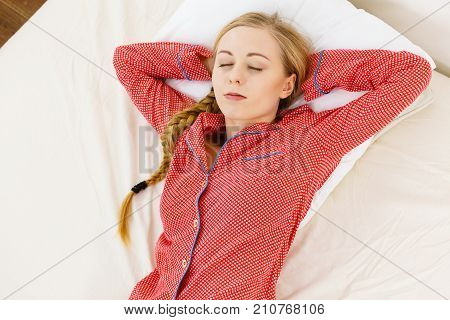 Woman Sleeping In Bed On Back