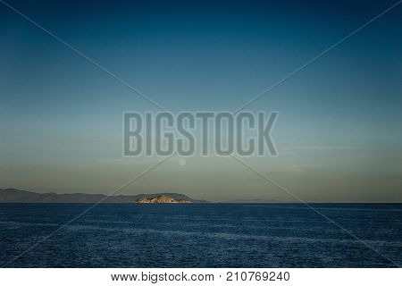 Small Island Neat Italy Coastline With Moon Above
