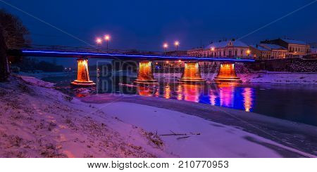 Panorama Of Bridge Through The River Uzh At Night