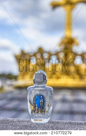 Holy water in a small bottle. Lourdes, France
