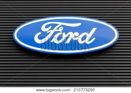 Skanderborg, Denmark - October 21, 2017: Ford logo on a wall. Ford is an American multinational automaker headquartered in Dearborn, Michigan, USA