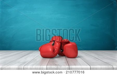 3d rendering of two red boxing gloves lying on a wooden desk in front of a blue blackboard background. Fighting skills. Boxing class. Learn defense.