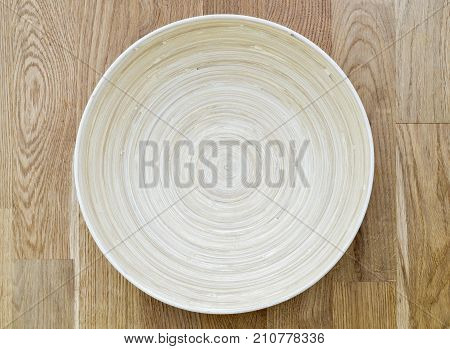 Empty wooden bowl on the floor. View from Top