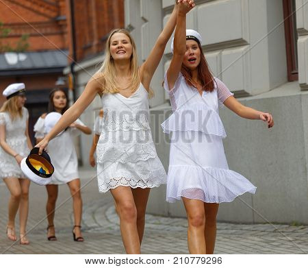 STOCKHOLM SWEDEN - JUN 13 2017: Smiling swedish female students in white resses after graduation at the school Norra Real June 13 2017StockholmSweden