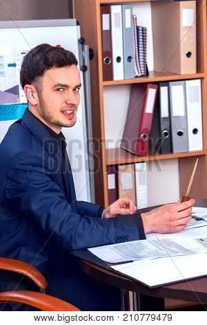 Happy business men boss at business office. He shuns from work. Employee caught unaware in workplace.