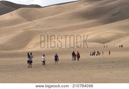 Great Sand Dunes National Park, Colorado - April 12, 2010: People walking on the Great Sand Dunes in Colorado