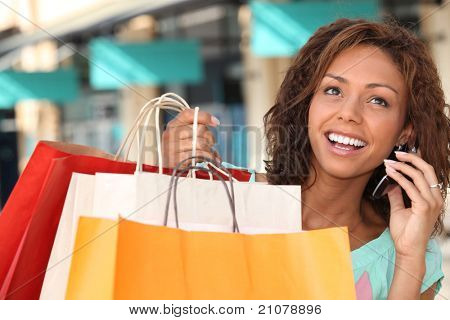 Woman shopping and talking on the phone