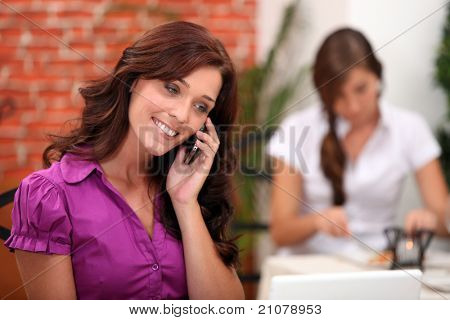 Woman in a restaurant on a mobile phone