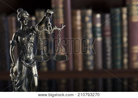 Law and justice symbol - Themis in the coudt library.