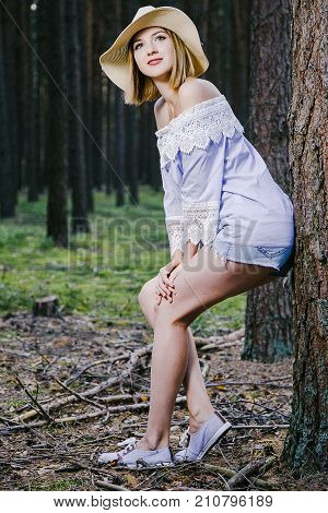 girl in the woods. young woman resting in the woods. wonderful weather in the woods.