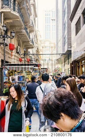 Shanghai, China - Nov 6, 2016: On Nanjing Road Pedestrian Street - Modern buildings in western architectural designs line the metropolitan area. Street crowded with visitors.