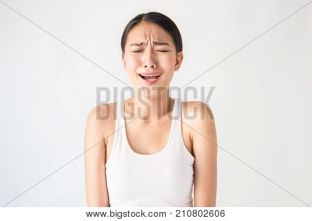 Beauty portrait of young asian woman has a funny face expression isolated on white background.